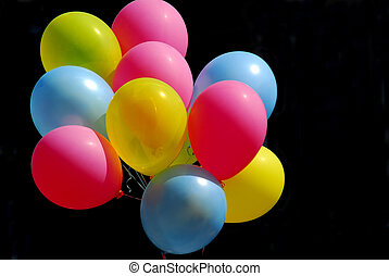 Colorful balloons on black background