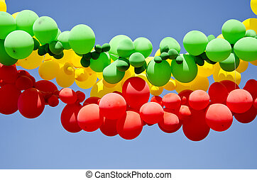 colorful balloons on sky background