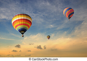 Colorful balloons with dramatic sky