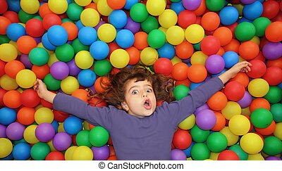 colorful balls funny park little girl lying gesturing