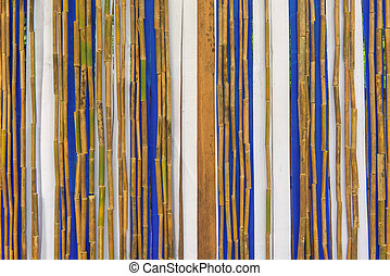 Colorful bamboo fence on wood texture for background