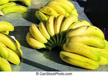 Colorful bananas at a market stall