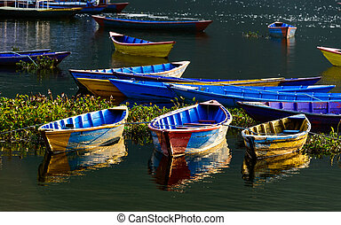 Colorful barques in Pokhara, Nepal - Colorful barques on...