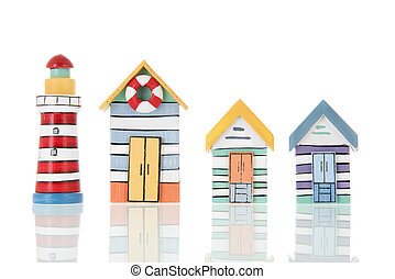 Colorful beach huts and light house