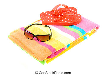 Colorful summer beachwear (flipflops), towel, and sunglasses