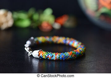 Colorful bead bracelet on a dark background