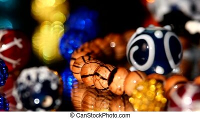 Colorful beads isolated on black background, close up, rotation