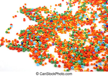 Colorful beads on white background.