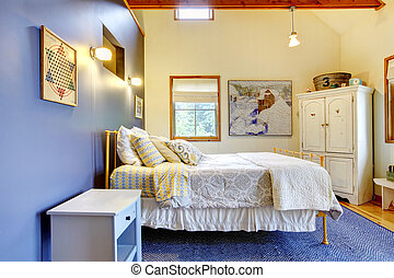Colorful bedroom with blue interior decor and white bedding.