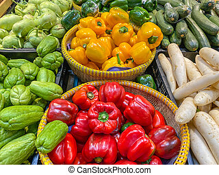Colorful bell peppers and other vegetables in groceries store