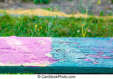 Colorful bench on green meadow background