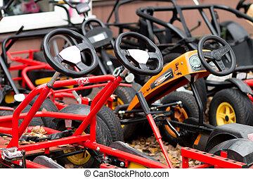 colorful bicycles in autumn amusement park
