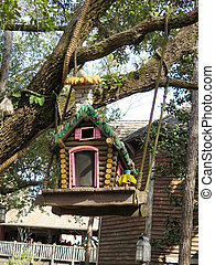 Colorful birdhouse in the forest