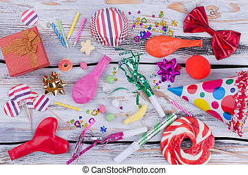 Colorful Birthday accessories on wooden background.