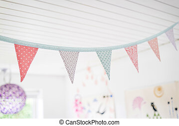 Colorful birthday flags in kids playroom