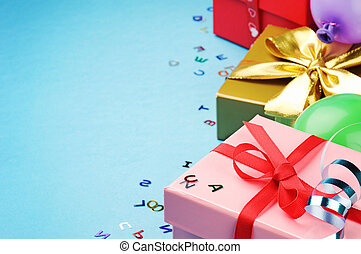 Colorful birthday gift boxes over blue background