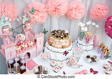 colorful birthday party table with cake