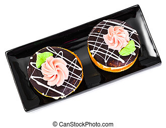 Colorful biscuits cakes bush with icing and custard filling....
