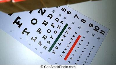 Colorful blocks spelling out sight falling on eye test in...