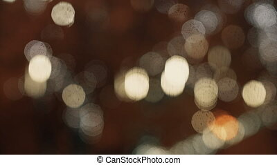 Colorful, blurred, bokeh lights background in warm tone. Abstract sparkles.