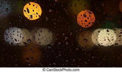 colorful blurry light traffic rain