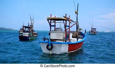 Colorful boats on blue water in sri lanka. - Colorful boats...