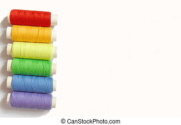 colorful bobbins isolated on white background, rainbow colors