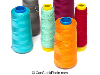 Colorful bobbins isolated on white