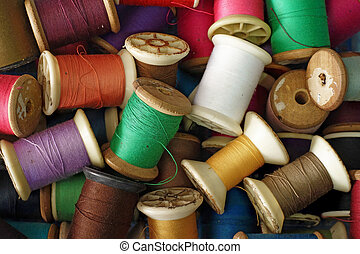 colorful bobbins of thread as background