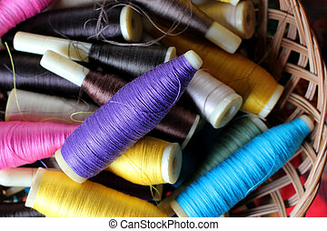 colorful bobbins of thread