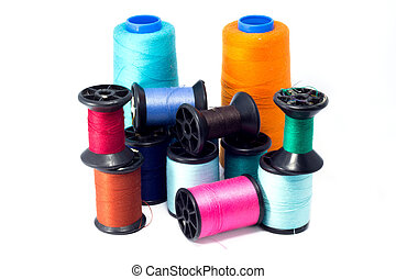 Colorful bobbins of thread isolated