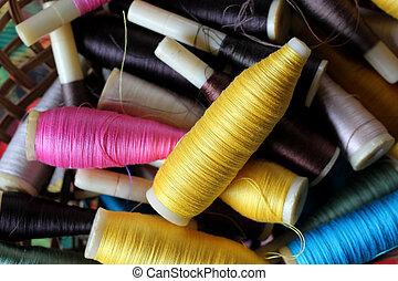 colorful bobbins of thread