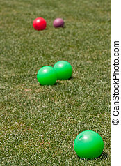 Colorful Bocce Balls in Green Grass