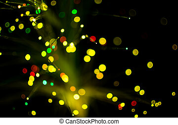 Colorful bokeh circle light celebrate at night, defocus light abstract yello background.