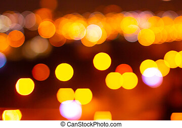 Colorful bokeh defocused blurred lights of cityscape. Abstract background