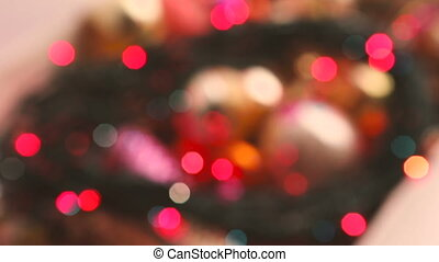 Colorful bokeh lights moving close up.