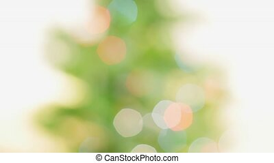 Colorful bokeh of Christmas lights tree. Pan
