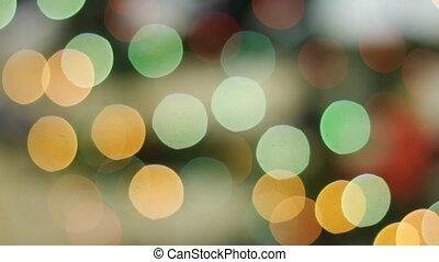 Colorful bokeh of Christmas lights tree. Pan