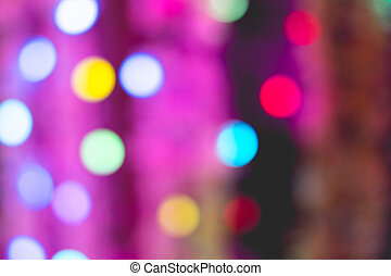Colorful bokeh of light on black background.