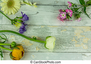 Colorful bouquet on a white rustic wooden background