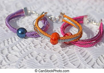 colorful bracelets and other craft items of jewelry