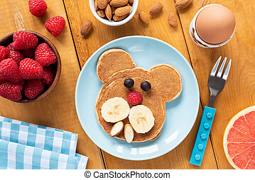 Colorful breakfast for kids, funny pancake, egg and fruits