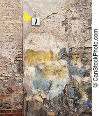 colorful brick wall and plate with a number seven