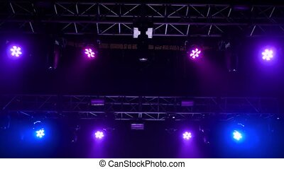 Colorful bright concert lighting equipment for stage at nightclub, illumination of entertainment musical show, party or performance. Nightlife, music, entertainment and technology concept