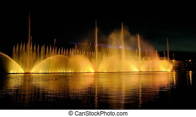 Colorful bright fountain with beautiful reflection