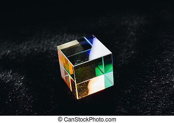Colorful bright glass prism cube  Refracting light in vivid ...