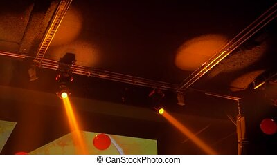 Colorful bright orange concert lighting equipment for stage at nightclub, illumination of entertainment musical show, party or performance. Nightlife, music, entertainment and technology concept