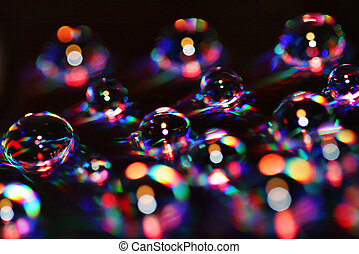 Colorful bubbles - Water drops over a DVD become colorful...