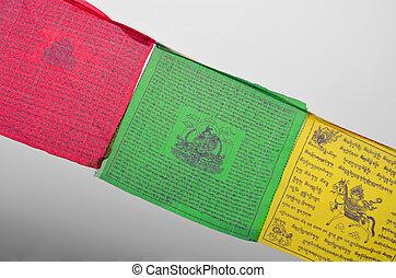 Colorful Buddhism prayer flags (Dar Cho, lungta) wth Buddism symbols.