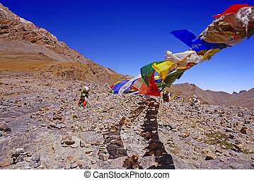 Colorful Buddhist Flags on a High Mountain Pass in the Himalayas